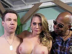 Have a blast watching this blonde cougar, with giant boobs and a nice ass, while she has fun with a black dude and her cuckold in a backstage clip.