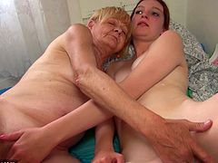 This old blonde nanny licks the tiny titties of her young redheaded lover, and she plays with the young dykes cunt, too. The nanny is not done yet. She sticks her face deep into her young lover's cunt and licks that wet pussy.