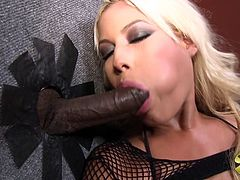 A hot blonde girl in sexy clothes poses for a camera near a dancing pole. Bridgette also sucks and rides two big black cocks in a gloryhole video.