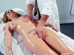 Watch this hardcore scene where the busty Ashley Graham gets an oil massage before being fucked by this guy until she's facialized.
