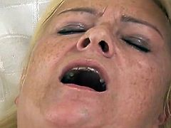 Lustful blonde mom has got saggy tits and hairy pussy. She moans wild getting pounded bad in her ass. Dirty anal sex scene is presented to you by Fame Digital.