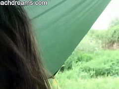 Nude Beach Dreams brings you a hell of a free porn video where you can see how a nasty brunette slut gets her mouth banged in a tent while assuming very hot poses.