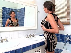 Busty brunette babe admires herself in the bathroom. She strokes her boobs and foams. Enjoy watching well stacked brunette in the shower.