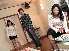 Two captivating Japanese whores give a terrific blowjob to a guy. Then the dude fingers the sluts' butts and fucks them in the cowgirl and other positions.