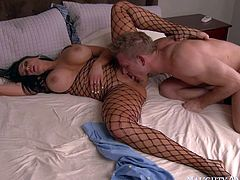Busty Audrey Bitoni in fishnet outfit riding dick like crazy