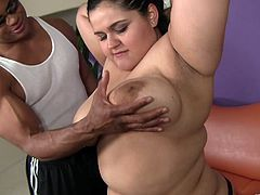 Get a load of this interracial scene where this BBW brunette shows off her big natural tits before sucking this guy's big black cock before being fucked.