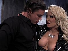 This sexy blonde milf invites her younger lover into the dungeon for some hardcore sex. She looks super hot in her leather outfit. It's time for her to get down on her knees and suck his stiff rod. She takes his big dick in her cunt, too.