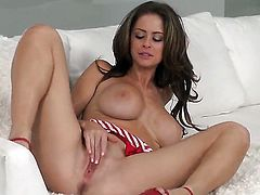 Emily Addison with giant jugs and bald twat makes her sexual fantasies a reality in solo action