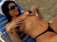 Stunning brunette, Romi Rain, wearing a bikini, is getting naughty with a guy indoors. She lets him eat her shaved coochie and they have sex in the reverse cowgirl position afterwards.