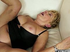 Malya is a busty granny with a bushy cunt. She has a younger lover, named Leslie, who loves to bury his cock in her hairy muffin. She fully enjoys his stiff cock.