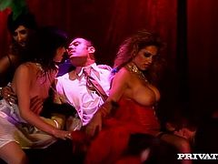 All the people in this video are in old style dresses. Three lustful chicks go wild at a private party. They suck big dicks passionately and of course get fucked in their wet cunts.