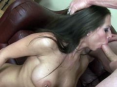 This soft couch seems perfect for busty angel's naughty needs in engulfing the guy's dick