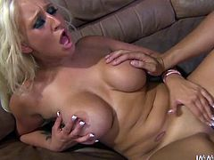 Light haired lassie with ugly plastic boobs stimulates her sensitive clit with high powered vibrator while hunky dude drills her soaking snatch with her legs wide open.