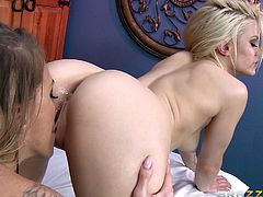 Ash Hollywood and Juelz Ventura are having lesbian fun in a massage parlor. The blonde pets her tattooed GF, then they lick each other's cunts and toy each other's assholes.