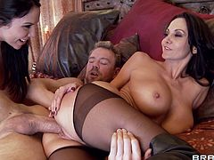 A very sexy, brunette pornstar with big, fake tits enjoys a mind-blowing threesome fuck. Hear her moan with pleasure now!