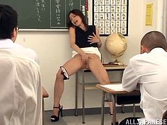 Sayuri Honjyou is a lustful Asian teacher. She gets so damn horny that masturbates in front of a class. Then she drops to her knees and gives head to several guys.