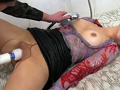 Two black haired lesbians go surely mad tonight. They take a shower while being fully dressed. One of the chicks lies and jams her tits while the other bitch in blouse stimulates her wet pussy with a clitoral vibrator.