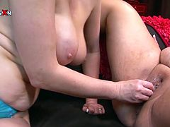 These unbelievably horny women are rimming each other's pussies using their favorite sex toy. Grab your throbbing dick and get ready for the hottest lesbian sex scene ever.
