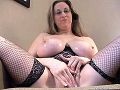 Huge-breasted mom Kitty Lee, wearing glasses, kneels in front of a dude and sucks his cock. Then the dude pounds Kitty's meaty cunt and uses her lips as a cum target.