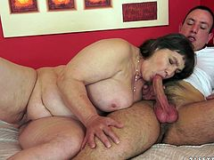 Irma is a fat granny. She kisses a handsome guy and then takes her clothes off. The guy licks Irma's huge boobs and shaved pussy. She gets fucked and creampied.