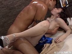 Salacious Japanese mom is having fun with a dude indoors. She admires the guy with her cock-sucking talent and then fucks him in the cowgirl position.