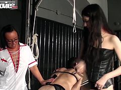 The nurse and her leather bound partner are going to have their way with their male sex slave. They spank the male bitch with the paddles, draw on his face and then make him lay back on the table to get tugged off like a slut. They suck him and jerk him to completion, and he has no say in the matter.