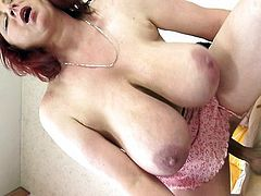 Redhead with huge saggy tits