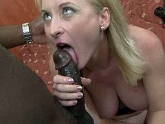 Trashy hooker sucks black dildo while getting drilled deep up her butt hole in a doggy position. Brutish black stud gives her no mercy.