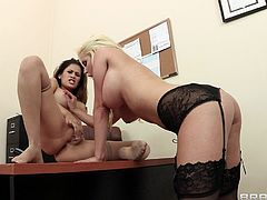Press play on this stunting lesbian scene where these gorgeous ladies have an outstanding lesbian scene where they fuck one another with a strapon in the office.