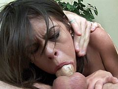 Her mouth slides perfectly down the guy's massive cock as cutie struggles to deepthroat him like never before