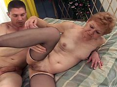This kinky young guy loves to fuck mature sluts. For this ones he tries to satisfy cougar woman living next door while her husband is out.