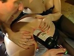 Dirty minded dudes applied a bottle of red wine to please loose button hole of that seductive black haired hottie in doggy position. Just watch that hard anal 3 some in The Classic Porn sex clip!