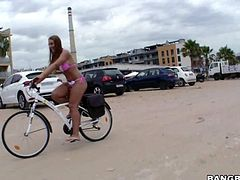 Naughty sexy Kyra Hot in pink bikini shows off her bubble butt and flashes her pussy while riding a bicycle. Then she gets her tits sucked and her mouth banged by horny dude in front of curious guys. She loves public sex!