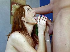 Attractive and sexy red haired babe with awesome body squats down and gives a wonderful blowjob. Have a look at this whore in My XXX Pass sex video.