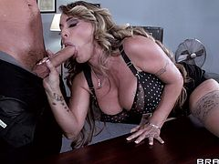 A hot, blonde cougar with big, fake tits and a shaved pussy enjoys a hardcore fuck session in her office. Hear her scream with pleasure now!