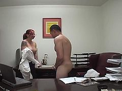 Feverish red haired office whore does everything her boss wants. This time mean dude wants to get his poor cock bitten, spanked and sucked.