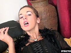 Kinky girl is wearing fishnet stockings and high heel shoes. She puts her thongs aside exposing bushy pussy. Lusty girl plays with her pussy in front of the camera.