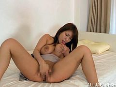 A beautiful Japanese girl massages her juicy boobs and licks them. Yume Mizuki also fingers and toys her vagina with a vibrator.