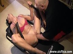 This brunette wife has a bald husband with a chubby hand. She gets fisted by him in her pierced pussy while exercising on a fitness machine in her comfort of her own home.
