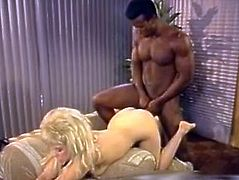 Amazing blond haired booty babe with awesomebody and nice ass gets her dripping pussy fucked hard missionary by the black cock. Have a look at this chick in The Classic Porn sex clip.