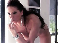 Angel Dark touches her jugs playfully
