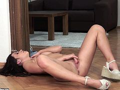 Take a nice look at this brunette babe, with natural boobs wearing high heels, while she touches herself with passion until she has an orgasm.