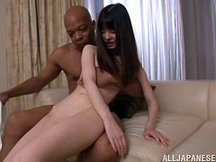 A slim Japanese chick is having fun with a bulky black dude. The girl shows her shaved pussy to the man and lets him finger it and rub it with a dildo.