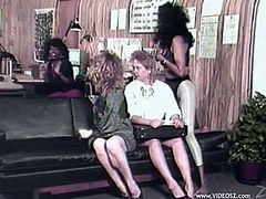 Two White and two Black MILFs have a lesbian orgy. These slutty women lick and toy each others pussies in an office.