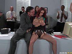 Check out this great hardcore scene where the busty Monique Alexander sucks and fucks on of her coworkers in the middle of the office while everyone watches.