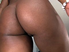 A chubby, ebony-skinned woman with big, natural tits and a hairy pussy enjoys a hardcore, interracial fuck. Hear her scream with pleasure now!