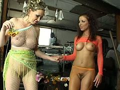 Witness this video where two lesbian cougars, with nice back doors wearing fishnet pantyhose, while they stimulate one another's pussies.