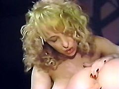 Bootylicious harlot with nice tits posed doggy style and got her hot pussy pounded with big nude dildo from behind by her pal. Look at that steamy lesbo sex in The Classic Porn sex video!
