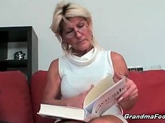 This old man is browsing through a porn magazine and touching himself. His hot wife notices, so she pulls his cock out of his pants and starts to jerk it off.