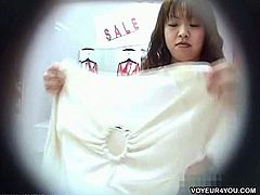 These Asian women try on a few types of sexy lingerie. They have no idea there is a camera in the dressing room and behave like they are all alone in there.